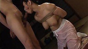 Bound Japanese MILF sucks chiefly a hard cock
