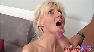 Fair-haired mature rides a young hard cock