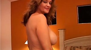 Downhearted MILF plays relating to her pussy and blows the cameraman