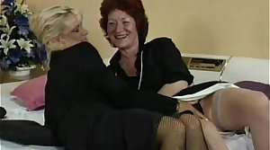 Granny fucks her swishy friend's pussy with strapon