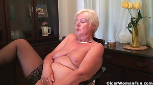 64 year grey and British granny Sandie rubs her grey pussy
